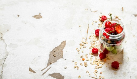 wild oats: Fitness food. Ripe wild berries with the oats. On rustic background.