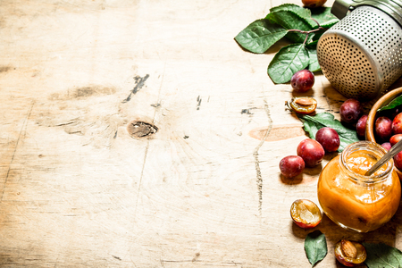 pulp: Fresh plum pulp in a glass jar. On wooden background. Stock Photo