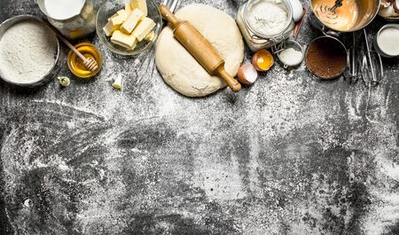 Dough background. Fresh dough with a variety of ingredients on rustic background.
