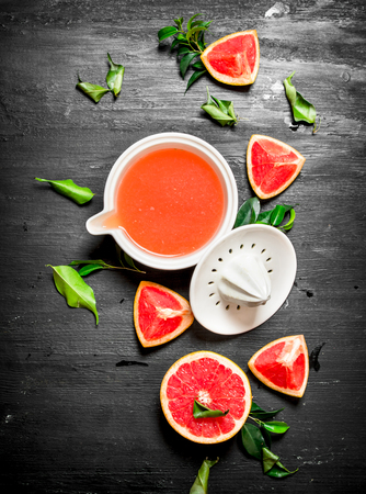 Fresh juice from grapefruits. On a black chalkboard.
