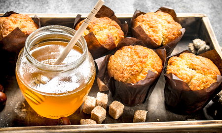 Honey muffins with nuts on an old tray. On a rustic background. Stock Photo