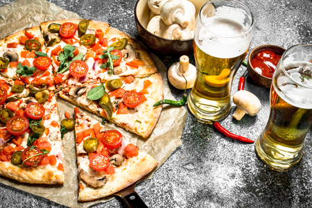 Mexican pizza with cold beer. On a rustic background. Stockfoto