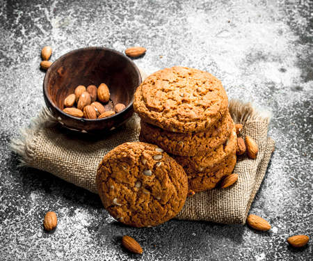 Oatmeal cookies in a bowl with nuts. On a rustic background. Stock Photo