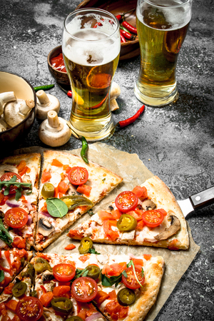 Mexican pizza with cold beer. On a rustic background. Archivio Fotografico