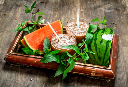 Watermelon mint smoothie. On a wooden background.