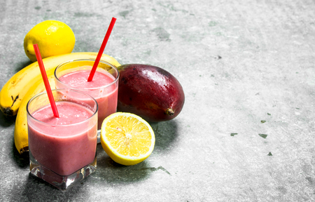 Fresh fruit smoothie . On rustic background