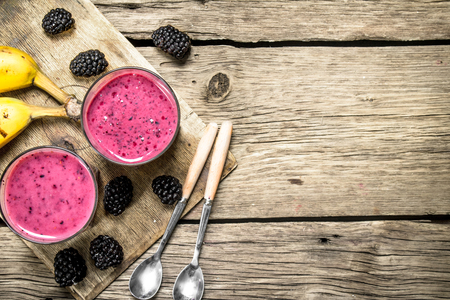 Blackberry fresh smoothie. On a wooden table. 스톡 콘텐츠