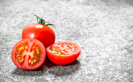 Fresh ripe tomatoes . On rustic background