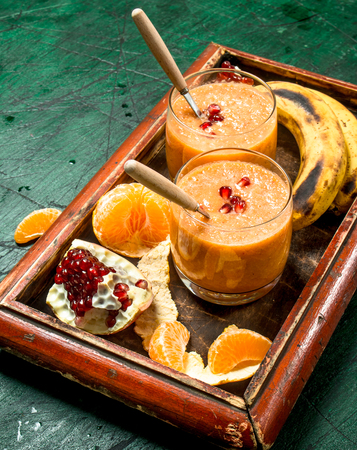 Fresh fruit smoothie. On rustic background