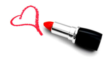 Heart and lipstick. On white background.