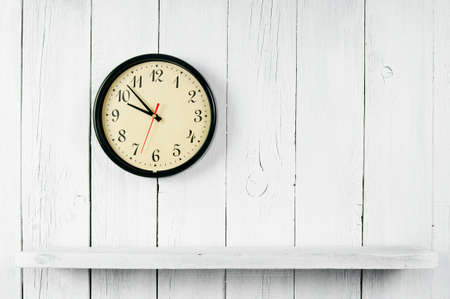Watches and a wooden shelf. On a white, wooden background. Stock fotó