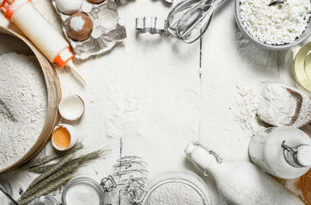 Baking background. A frame of fresh ingredients for dough.