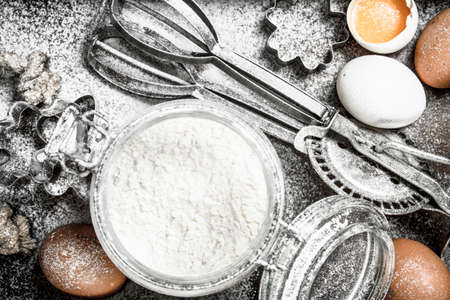 Baking background. Ingredients for fresh dough. On a wooden background.