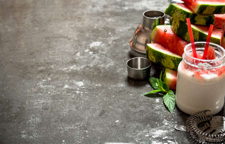 Watermelon smoothie with mint. On the stone table. 스톡 콘텐츠