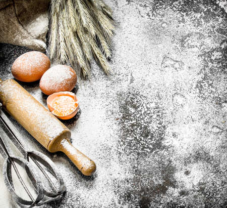 Baking background. Ingredients and tools for dough preparation. On a rustic background.