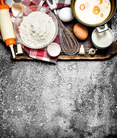 Baking background. Fresh ingredients for baking. On rustic background. Reklamní fotografie