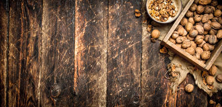 Shelled walnuts. On wooden background. Top view