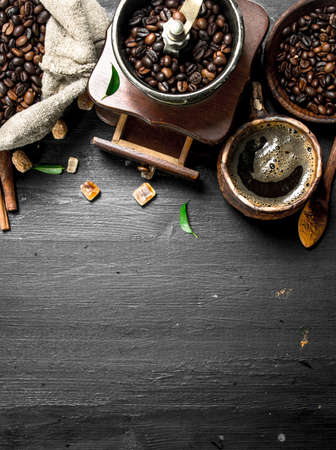 Coffee background. Fresh coffee with sugar crystals and coffee beans. On the black chalkboard.