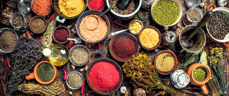 Various fragrant spices and herbs. On a wooden background. Standard-Bild