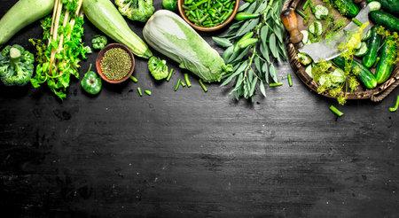 Organic food. Fresh cucumbers with herbs. On the black chalkboard. Standard-Bild