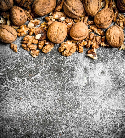 Walnuts . On the rustic background. top view