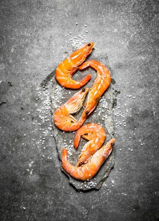 Shrimp with salt. On a stone background.