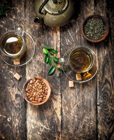 Chinese flavored tea. On a wooden background.