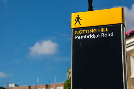 notting: Notting hill walking sign with blue sky Stock Photo