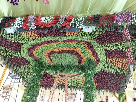 Ceiling of the stage is decorated with fruits, flowers and leaves
