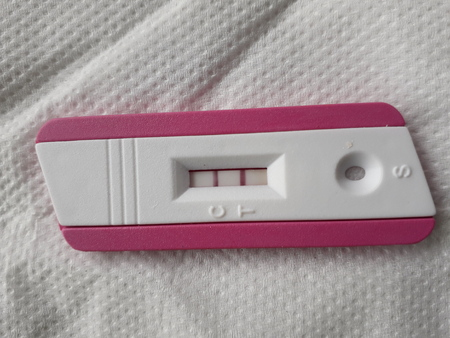 pregnancy test with positive result with two pink lines Stock Photo