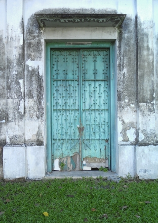 Blue Door with dirty walls photo