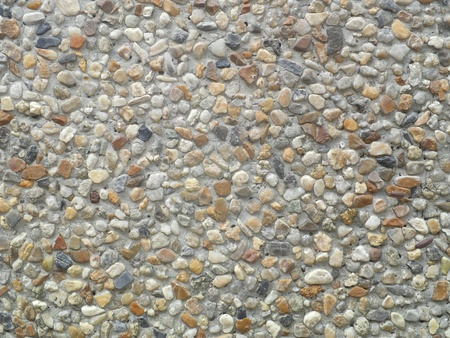 Decorative gravel floor or wall pattern for use as background texture in close-up photo