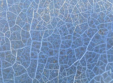 Peeling paint on wall seamless texture. Pattern of rustic blue grunge material photo