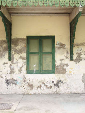Vintage window on green cement wall photo