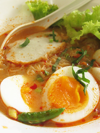 Thailand noodle soup with pork egg photo