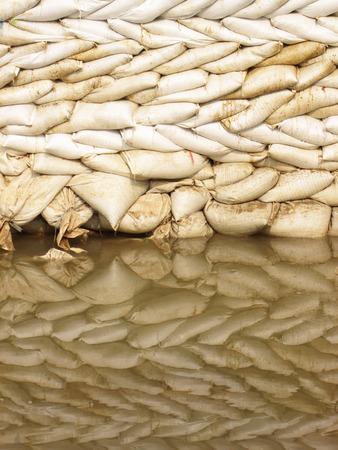 sandbag: sack of sand and its reflection