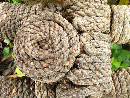 braided flexible: Ropes tied in use for so long that it fell apart completely overhauled look to lean on for safety Stock Photo