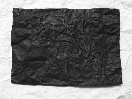 Crumpled black paper photo