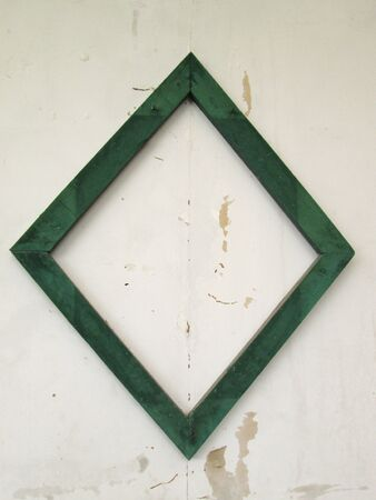 blank photo frame on old wall photo
