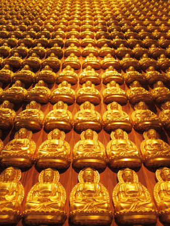 NONTHABURI-THAILAND -February 14 : DOF of Many Golden Buddha statue in Chinese temple, Buddha is the worship of Thai Buddhist on February 14 2013, Nonthaburi Province, Thailand Stock Photo