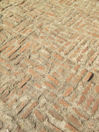 Old Medieval Brick Pavement Pattern Detail photo
