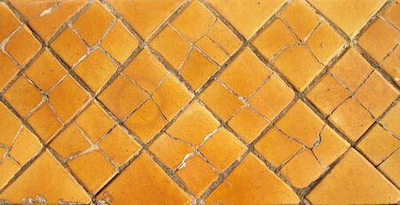 Cracked golden tile in Wat Pho temple , Bangkok Thailand photo