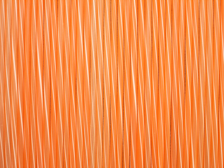 Straws orange background photo