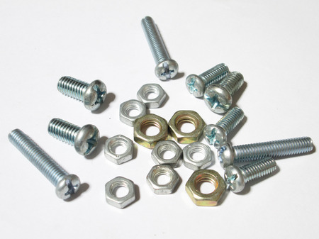 Steel screws and nuts background photo