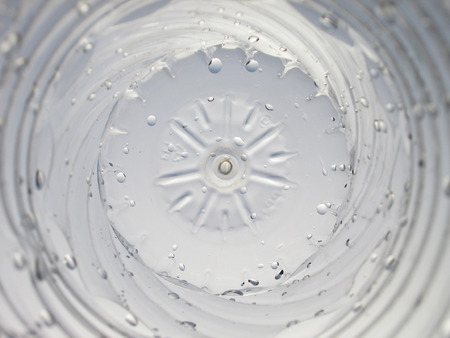twirling: Bottom of a plastic water bottle
