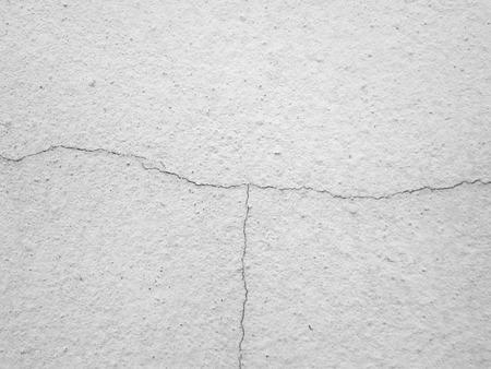 decorative wall: Cracks on gray cement walls Stock Photo