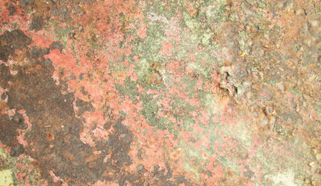 Plate of metal rusty on all background, with old layers of a paint photo