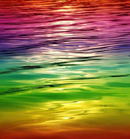 seawater: rainbow shimmering Seawater Background Stock Photo