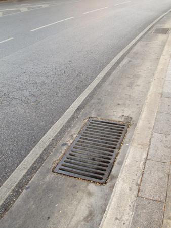 crack pipe: Steel pipe cap on asphalt road Stock Photo
