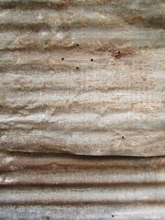 siding: Rusted, galvanized, corrugated iron siding, vintage background Stock Photo